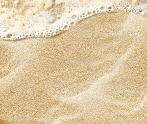 Soft wave of the sea on the clean sandy beach.